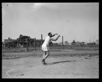 Track and field athlete appears to partake in a throwing event at the Pacific Fleet's championship track meet, Long Beach, 1922
