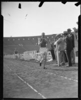 Track athlete at the finish line on the track at the Coliseum, Los Angeles, 1926