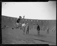 U.S.C track athlete engaged in a jump at the Coliseum, Los Angeles, 1926