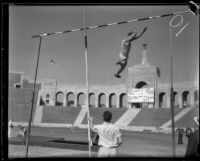 Stanford vaulter leaps over the bar during a pole-vault attempt during the S.C. and Stanford dual track meet, Los Angeles, 1934