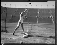Stanford thrower putting a shot during the S.C. and Stanford dual track meet, Los Angeles, 1934