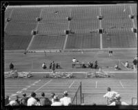 Distant view of a race at the S.C. and Stanford dual track meet at the Coliseum, Los Angeles, 1934