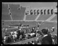 Runners race around a curve during the S.C. and Stanford dual track meet, Los Angeles, 1934