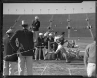 S.C. Trojan relay runner sprints through the finish line during the dual track meet against Stanford, Los Angeles, 1934