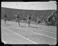 S.C. sprinter crosses the finish line during a race at the S.C. and Stanford dual track meet, Los Angeles, 1934