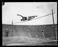 U.S.C. high jumper leaps over the bar during the U.S.C. and Occidental dual track meet, Los Angeles, [1926]
