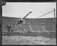 U.S.C. high jumper fails his jump attempt during the U.S.C. and Occidental dual track meet, Los Angeles, [1926]