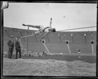 Occidental high jumper knocks over the bar on his jump attempt during the U.S.C. and Occidental dual track meet, Los Angeles, [1926]