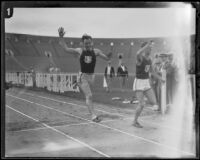 Les Heilman breaks the U.S.C. mile record while Ralph Shawhan trails behind during a dual track meet versus Occidental, Los Angeles, 1926