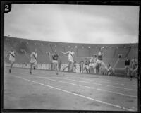 U.S.C. sprinter, Ed House, crosses the finish line in the 100-yard dash during a dual track meet versus Occidental, Los Angeles, 1926