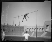 Lee Barnes of U.S.C. sets a new American record in the pole vault during the A.A.U. Relays, Los Angeles, 1926