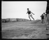 University of California athlete performing a long jump, Los Angeles, 1932