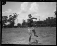 Bud Houser, USC track team athlete, in training on campus, Los Angeles, 1925