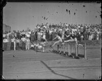 Kenny Knight, Jimmie Meeks, and Bernie Miller complete the last hurdle of their race, Los Angeles, 1932