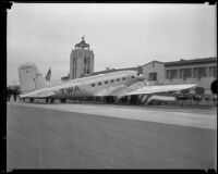 TWA aircraft, City of Los Angeles, sits outside the Grand Central Air Terminal for its dedication, Glendale, [1933]