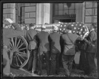 Pallbearers place William Traeger's casket on caisson at Patriotic Hall, Los Angeles, 1935