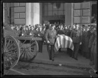 Pallbearers carry William Traeger's coffin out of Patriotic Hall after funeral services, Los Angeles, 1935