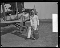 Parachutist John Tranum prepares for a jump, Los Angeles, 1928