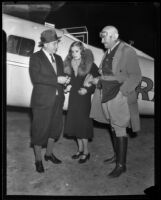 Joseph M. Schenck and Lili Damita after Colonel Roscoe Turner lands their flight, Los Angeles, 1932