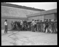 Members of the first civilian coast artillery crew load a mortar battery gun at Fort MacArthur, San Pedro, 1921
