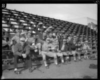 Members of the USS Tennessee baseball team sitting in the bleachers cheering, 1925