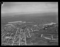 Aerial view of towards harbor with ships from the Navy's Pacific Fleet in the background, San Pedro