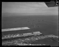 Aerial view of San Pedro harbor with ships from the Navy's Pacific Fleet in the background