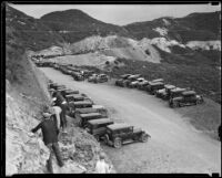 Four men work on widening the road through Griffith Park, Los Angeles, 1933