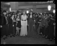 Fashion models at J. W. Robinson Co. department store wearing dresses from different eras, Los Angeles, 1933