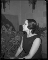 Artist Maroussia Valero seated in profile, circa 1932