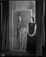 Artist Maroussia Valero standing next to her painting of a spanish woman, circa 1932