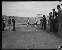Redlands University runners Marvin Vancil and Allen Griffin cross the finish line at the Rose Bowl, Pasadena, 1933