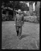 Cornelius Vanderbilt IV in front of a house, 1935