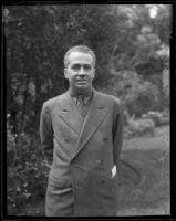 Cornelius Vanderbilt IV on a lawn in front of a house, 1935