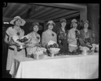 Women delegates from the Retail Merchants' Credit Association convention offer fruit, Los Angeles, 1926