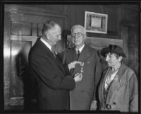 William May Garland receives the Order of the White Lion from Felix Janovsky with Madilene Veverka present, Los  Angeles, 1935