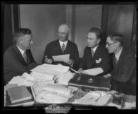 Attorneys L. W. Hammer, Roland Woolley and Arthur Veitch speak with Judge J. A. Bardin, 1929