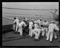Navy sailors aboard the USS Baltimore load the ship's gun, San Pedro, 1920