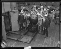 Navy sailors Gathered around a mine aboard the USS Baltimore, San Pedro, 1920-1921