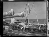 Two sailors walk the deck of a US Navy battleship