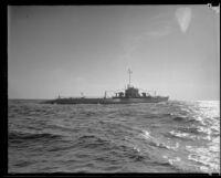 "A V-5 submarine ""N1"" streams through the water during the annual Navy Fleet Parade along the Southern California coast, 1932"