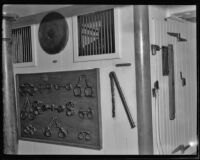 USF Constitution onboard museum exhibit of the brig, hand cuffs, leg irons and whip, San Pedro, 1933