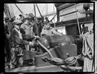 Three boys examine a cannon aboard the USF Constitution, San Pedro, 1933