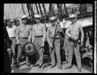 Four sailors with equipment on the USF Constitution, San Pedro, 1933