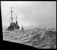 Three Navy cruisers steam through the water, Southern California, 1933