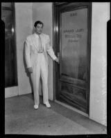 Actor John Warburton following Grand Jury testimony, Los Angeles, 1933