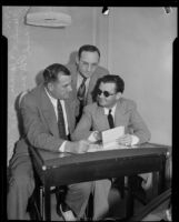 Police detectives sit with Edward Ward, accused of attempting to frame the police commissioner, Los Angeles, 1932