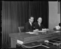 Justice William H. Waste seated next to Judge Joseph Marchetti in Marchetti's courtroom, Los Angeles, 1934