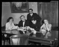Representatives from Angelus Temple with city officials during an investigation into of misuse of funds, Los Angeles, 1932