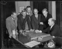 Los Angeles County Flood Control District engineers view plans with Supervisor Roger Jessup, Los Angeles, 1930